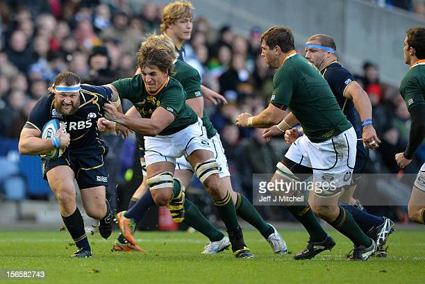 Ryan Grant of Scotland is tackled by Eben Etzebeth of South Africa during the international match between Scotland and South Africa at Murrayfield...