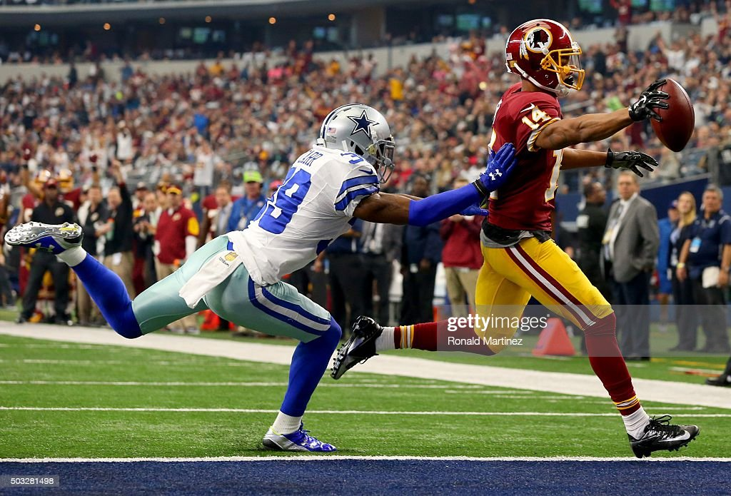 Ryan Grant #14 of the Washington Redskins takes the ball across the goal line to score a touchdown against Brandon Carr #39 of the Dallas Cowboys during the first half at AT&T Stadium on January 3, 2016 in Arlington, Texas.