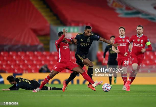 Ryan Gravenberch of Ajax is challenged by Georginio Wijnaldum of Liverpool during the UEFA Champions League Group D stage match between Liverpool FC...