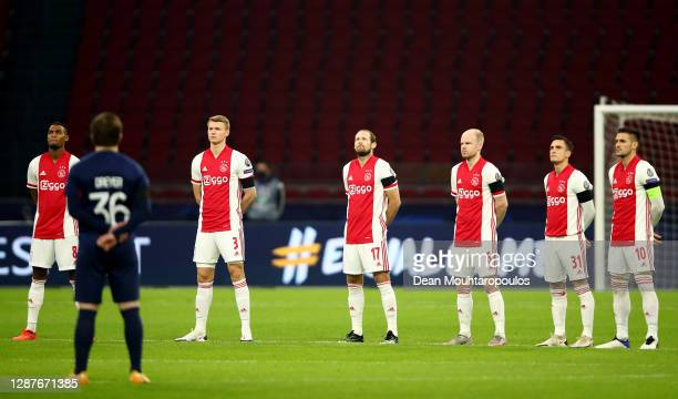 Ryan Gravenberch, Perr Schuurs, Daley Blind, Davy Klaassen, Nicolas Tagliafico and Dusan Tadic of Ajax take part in a minute of silence to remember...