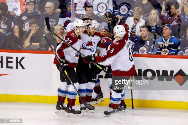 Ryan Graves JT Compher Matt Nieto and Erik Johnson of the Colorado Avalanche celebrate a second period goal against the Winnipeg Jets at the Bell MTS...