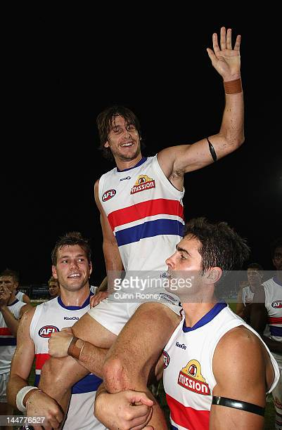 Ryan Griffen of the Bulldogs is chaired off the ground after playing his 150th game the round eight AFL match between the Western Bulldogs and the...