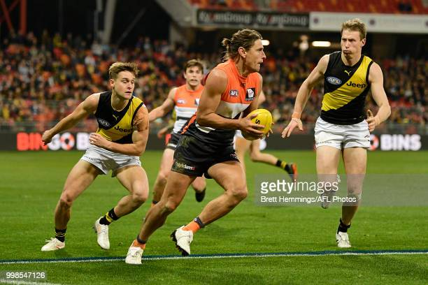 Ryan Griffen of the Giants runs with the ball during the round 17 AFL match between the Greater Western Sydney Giants and the Richmond Tigers at...