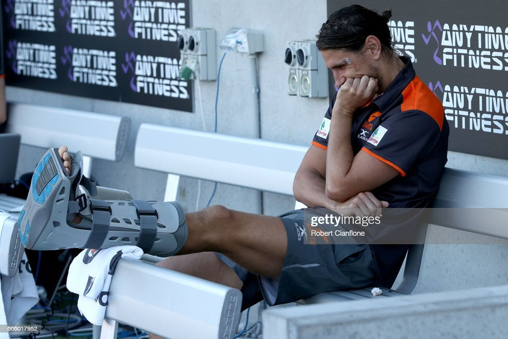 Ryan Griffen of the Giants sits on the bench injured during the round three AFL match between the North Melbourne Kangaroos and the Greater Western Sydney Giants at Blundstone Arena on April 8, 2017 in Hobart, Australia.