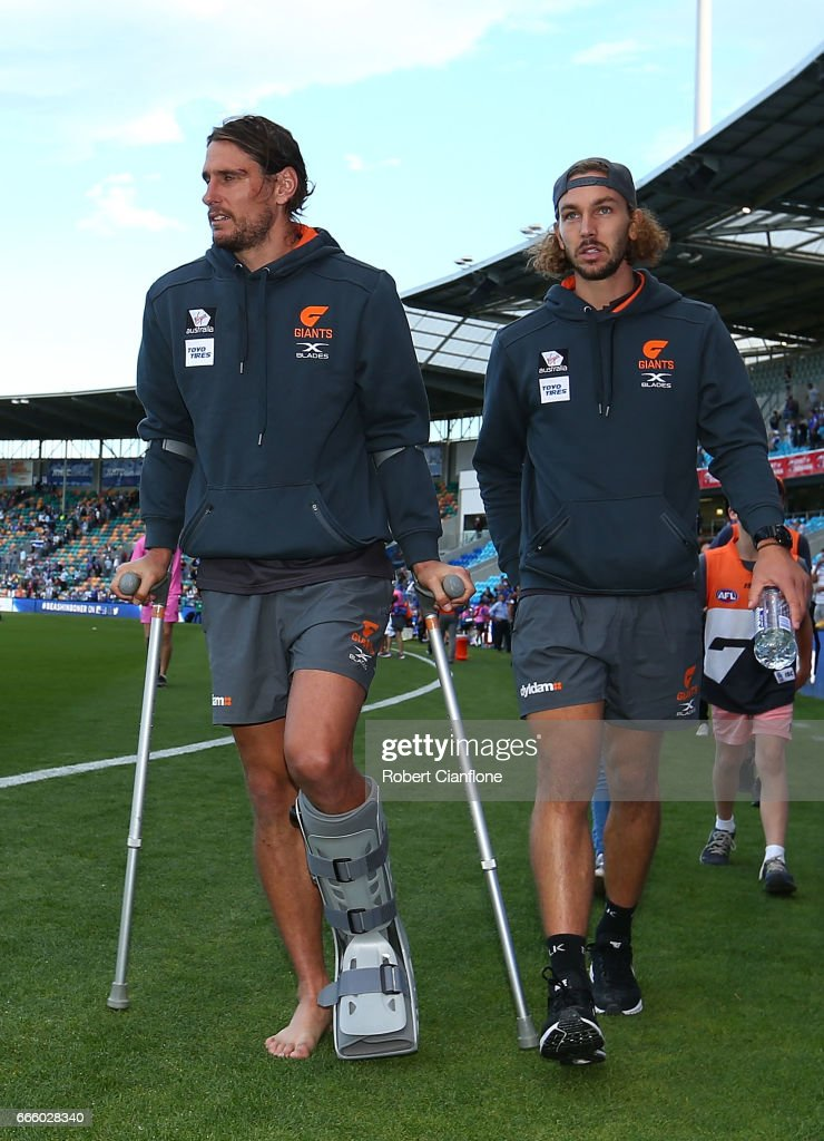 Ryan Griffen of the Giants walks off after the match after he was injured during the round three AFL match between the North Melbourne Kangaroos and the Greater Western Sydney Giants at Blundstone Arena on April 8, 2017 in Hobart, Australia.