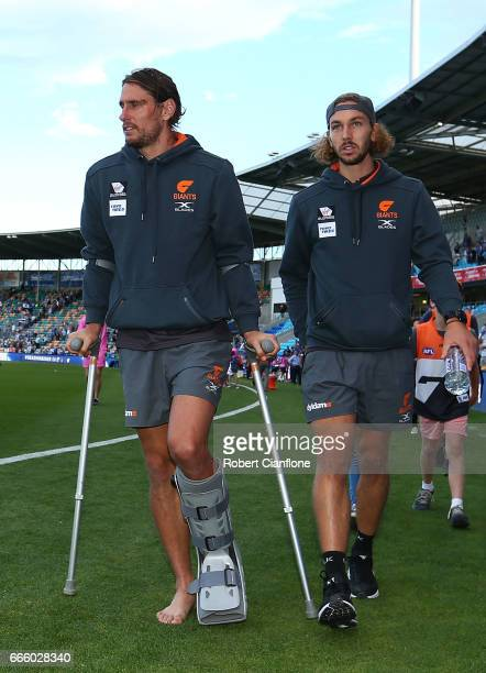 Ryan Griffen of the Giants walks off after the match after he was injured during the round three AFL match between the North Melbourne Kangaroos and...