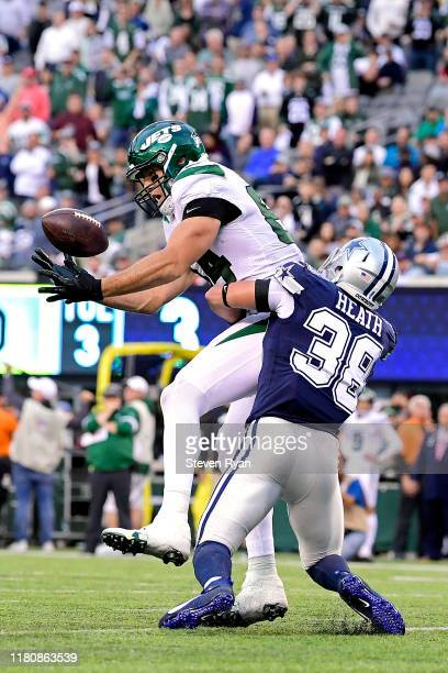 Ryan Griffin of the New York Jets catches the ball for a touchdown against Jeff Heath of the Dallas Cowboys during the second quarter at MetLife...