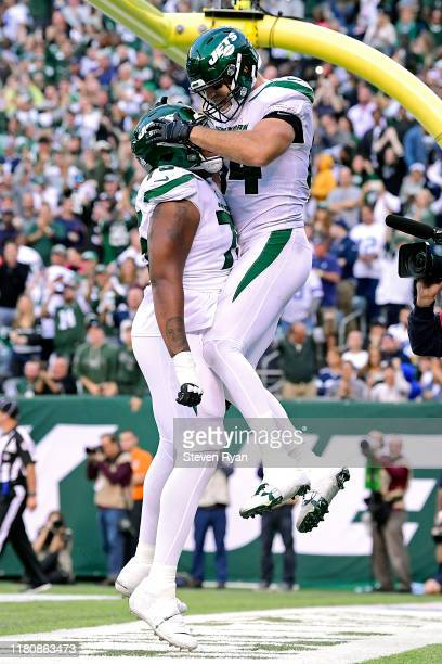 Ryan Griffin of the New York Jets is congratulated by his teammate Chuma Edoga after a catching the ball for a touchdown against the Dallas Cowboys...