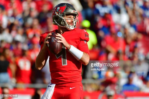 Ryan Griffin of the Tampa Bay Buccaneers drops back to throw a pass for the first time in the NFL during the third quarter of a game against the...