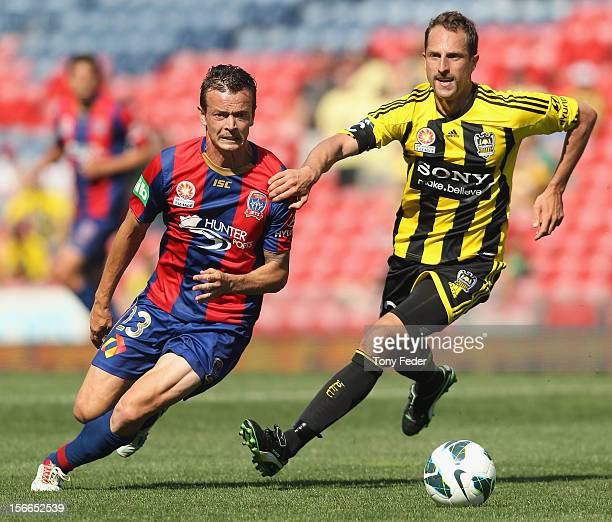 Ryan Griffiths of the Jets and Andrew Durante of the Phoenix contest the ball during the round seven ALeague match between Newcastle Jets and the...
