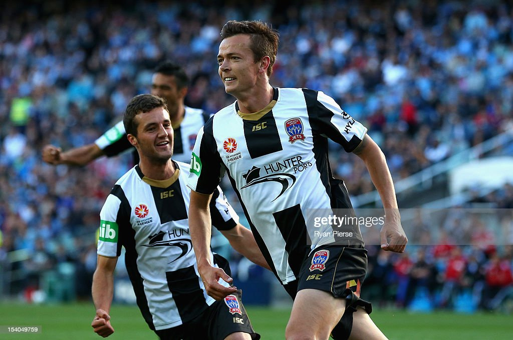 Ryan Griffiths of the Jets celebrates after scoring his team's first goal during the round two A-League match between Sydney FC and the Newcastle Jets at Allianz Stadium on October 13, 2012 in Sydney, Australia.