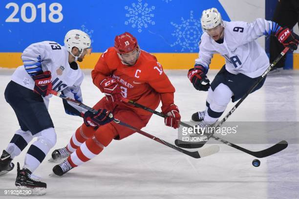 Ryan Gunderson Russia's Pavel Datsyuk and US Brian O'Neill vie for the puck in the men's ice hockey preliminary round group B game between the...