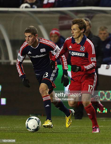 Ryan Guy of New England Revolution and Chris Rolfe of Chicago Fire fight for the ball at Toyota Park March 9 2013 in Bridgeview Illinois