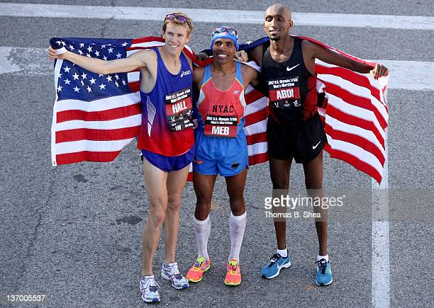 Ryan Hall Meb Keflezighi and Abdi Abdirahman celebrate holding the American flag after they competed in the US Marathon Olympic Trials January 14...