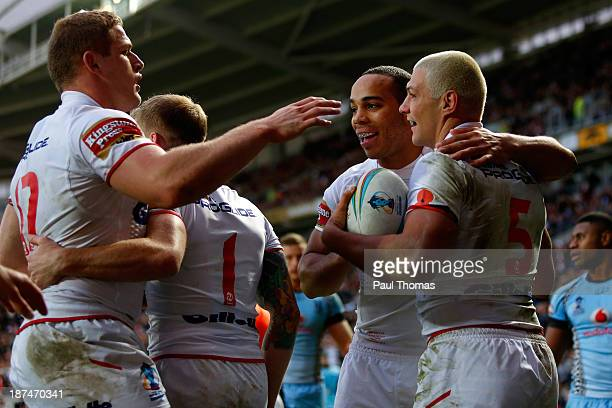 Ryan Hall of England celebrates his second try with team mates George Burgess and Leroy Cudjoe during the Rugby League World Cup Group A match at the...