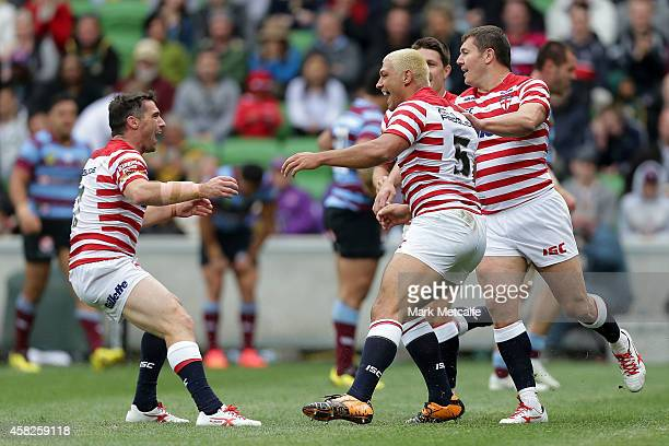Ryan Hall of England celebrates scoring a try during the Four Nations match between the Australian Kangaroos and England at AAMI Park on November 2...