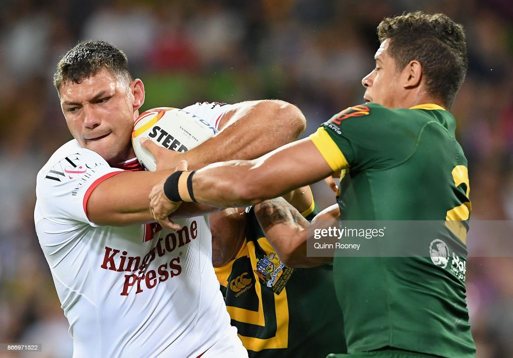 Ryan Hall of England fends off a tackle by Dane Gagai of Australia during the 2017 Rugby League World Cup match between the Australian Kangaroos and England at AAMI Park on October 27, 2017 in Melbourne, Australia.