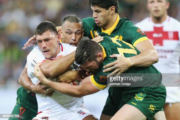 Ryan Hall of England gets tackled by Will Chambers Jordan McLean and Matt Gillett of the Kangaroos during the 2017 Rugby League World Cup match...