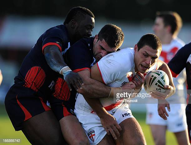 Ryan Hall of England is tackled by Michael Simon of France during the Autumn International Series match between England and France at Craven Park on...