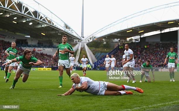 Ryan Hall of England scores his second try as Rory Kostjasyn attempts to cover of Ireland during the Rugby League World Cup Group A match between...