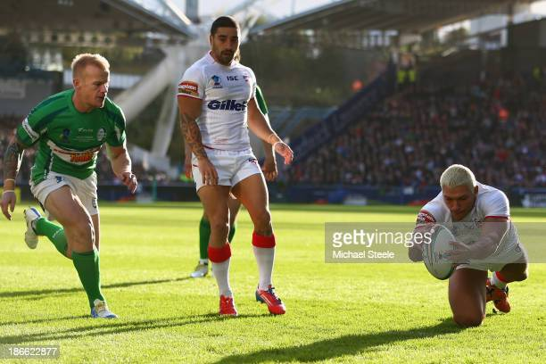 Ryan Hall of England scores his sides opening try as Damien Blanch of Ireland closes in during the Rugby League World Cup Group A match between...