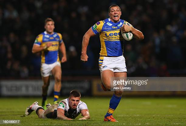 Ryan Hall of Leeds Rhinos breaks past a challenge from Joe Arundel of Hull FC on his way to scoring his try during the Stobart Super League match...