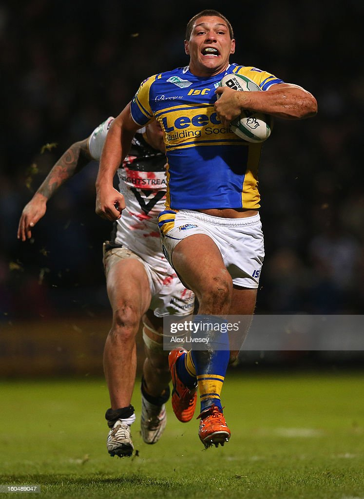 Ryan Hall of Leeds Rhinos breaks past Jason Crookes of Hull FC on his way to scoring his try during the Stobart Super League match between Leeds Rhinos and Hull FC at Headingley Carnegie Stadium on February 1, 2013 in Leeds, England.