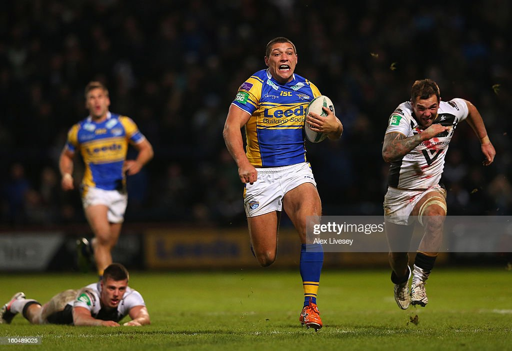 Ryan Hall of Leeds Rhinos breaks past Joe Arundel and Jason Crookes of Hull FC on his way to scoring his try during the Stobart Super League match between Leeds Rhinos and Hull FC at Headingley Carnegie Stadium on February 1, 2013 in Leeds, England.