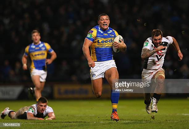 Ryan Hall of Leeds Rhinos breaks past Joe Arundel and Jason Crookes of Hull FC on his way to scoring his try during the Stobart Super League match...