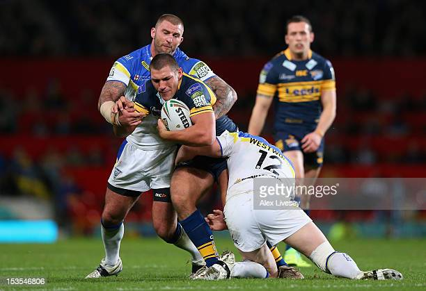 Ryan Hall of Leeds Rhinos is tackled by Ben Westwood of Warrington Wolves during the Stobart Super League Grand Final between Warrington Wolves and...