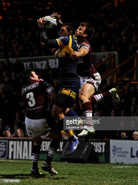 Ryan Hall of Leeds Rhinos jumps to catch the ball prior to scoring his second try during the World Club Challenge match between Leeds Rhinos and...