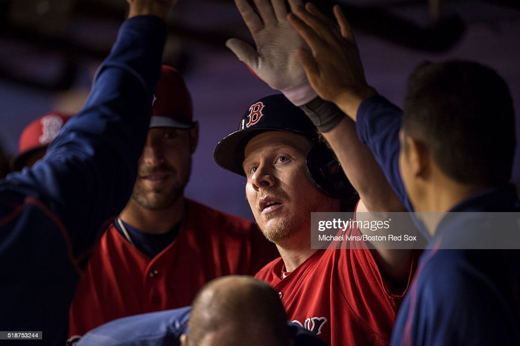Ryan Hanigan #10 of the Boston Red Sox is congratulated after hitting a home run against the Toronto Blue Jays on April 2, 2016 at Olympic Stadium in Montreal, Quebec.