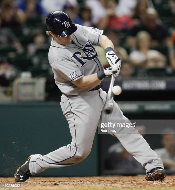 Ryan Hanigan of the Tampa Bay Rays singles in the ninth inning against the Houston Astros at Minute Maid Park on June 13 2014 in Houston Texas