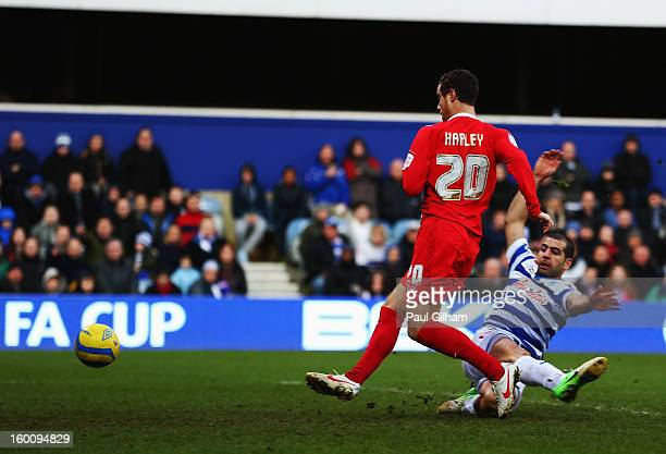 Ryan Harley of Milton Keynes Dons skips the challenge of Tal Ben Haim of Queens Park Rangers and scores his sides third goal during the FA Cup with...