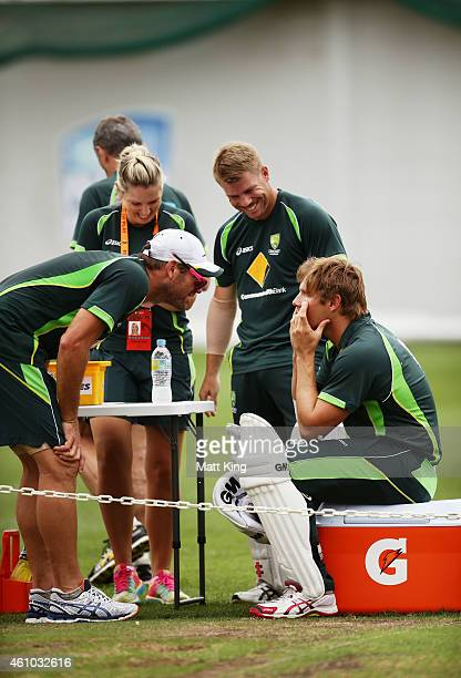 Ryan Harris and David Warner look into the eyes of Shane Watson during an Australian nets session at Sydney Cricket Ground on January 5 2015 in...