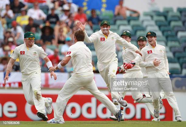 Ryan Harris and Michael Hussey of Australia celebrate taking the wicket of Matt Prior of England during day four of the Third Ashes Test match...