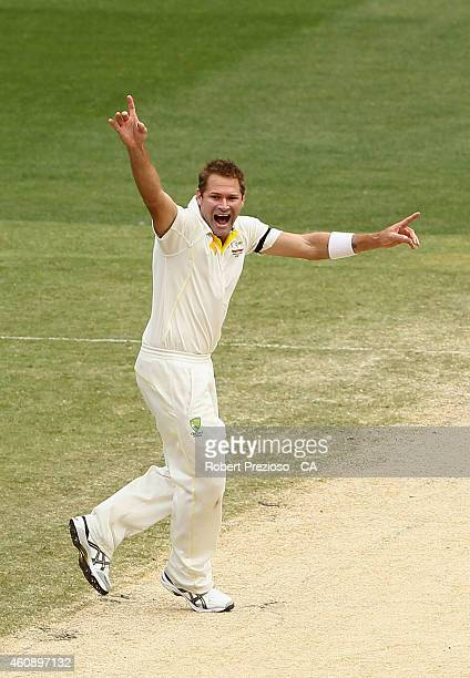Ryan Harris of Australia appeals successfully for the wicket of Shikhar Dhawan of India during day five of the Third Test match between Australia and...