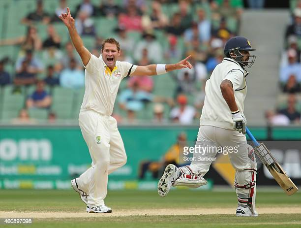 Ryan Harris of Australia appeals successfully to dismiss Shikhar Dhawan of India during day five of the Third Test match between Australia and India...