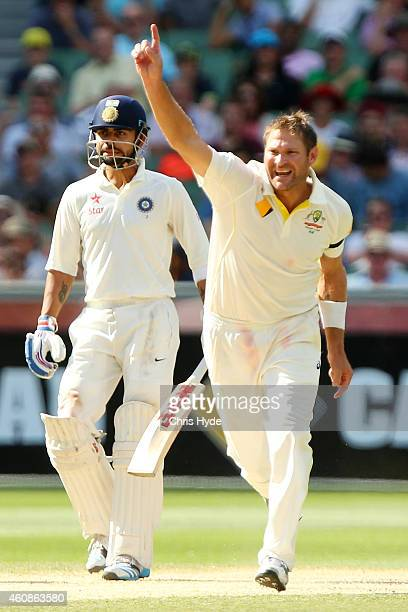 Ryan Harris of Australia celebrates dismissing Mahendra Singh Dhoni of India during day three of the Third Test match between Australia and India at...