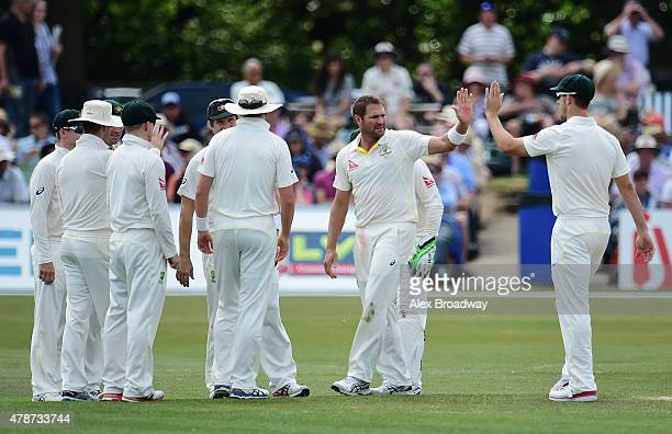 Ryan Harris of Australia celebrates dismissing Sam Billings of Kent during day three of the tour match between Kent and Australia at The Spitfire...