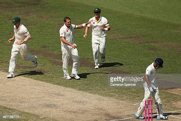 Ryan Harris of Australia celebrates taking the wicket of Virat Kohli of India during day four of the Fourth Test match between Australia and India at...