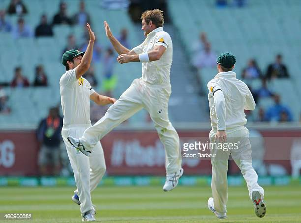 Ryan Harris of Australia celebrates with Joe Burns after dismissing Virat Kohl of India during day five of the Third Test match between Australia and...