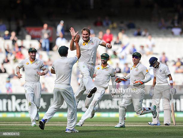 Ryan Harris of Australia celebrates with Joe Burns after dismissing Virat Kohl during day five of the Third Test match between Australia and India at...
