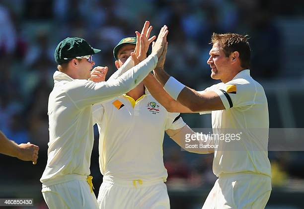 Ryan Harris of Australia celebrates with Steven Smith after dismissing Shikhar Dhawan of India during day two of the Third Test match between...
