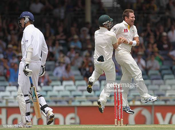 Ryan Harris of Australia celebrates with team mate Phillip Hughes after taking the wicket of Steven Finn of England to win the match during day four...