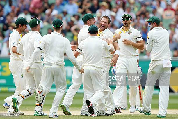 Ryan Harris of Australia celebrates with team mates after dismissing Ravichandran Ashwin of India during day three of the Third Test match between...