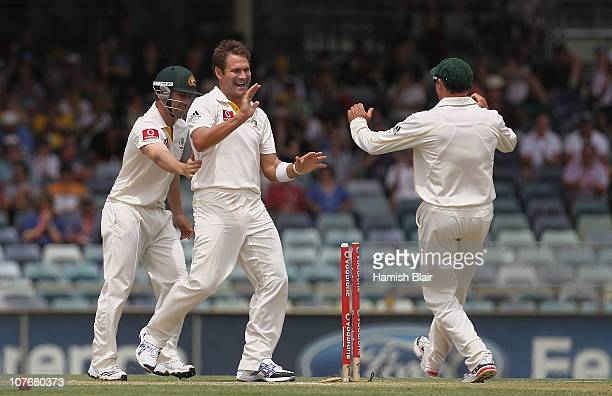 Ryan Harris of Australia celebrates with team mates after taking the wicket of James Anderson of England during day four of the Third Ashes Test...
