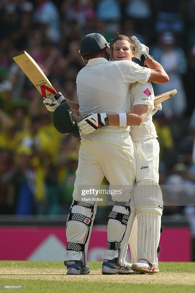 Ryan Harris of Australia congratulates Steve Smith of Australia as he celebrates reaching his century during day one of the Fifth Ashes Test match between Australia and England at Sydney Cricket Ground on January 3, 2014 in Sydney, Australia.