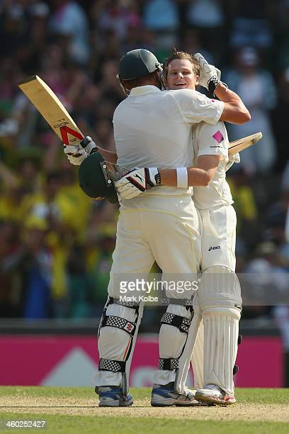 Ryan Harris of Australia congratulates Steve Smith of Australia as he celebrates reaching his century during day one of the Fifth Ashes Test match...