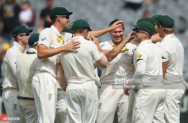 Ryan Harris of Australia is congratulated by team mates after getting the wicket of Virat Kohli of India during day five of the Third Test match...